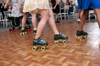 Bride & fellow derby players in Roller Skates